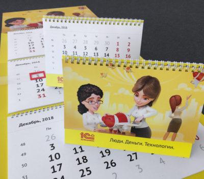 Печать больших квартальных календарей (400х1000 мм) и настольных перекидных календарей по брендбуку (тираж 20 и 20). Стоимость аналогичных календарей — 870 руб. большой и 295 руб. настольный
